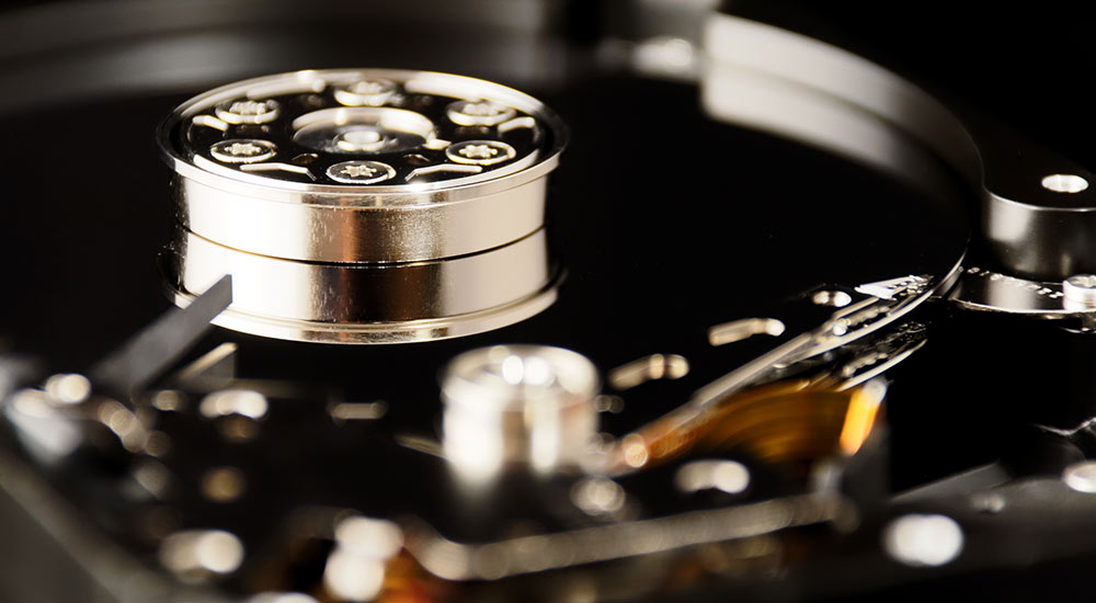 Photograph of a hard disk head and platter.