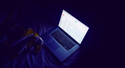 Photo of a laptop being used in a private session at night
