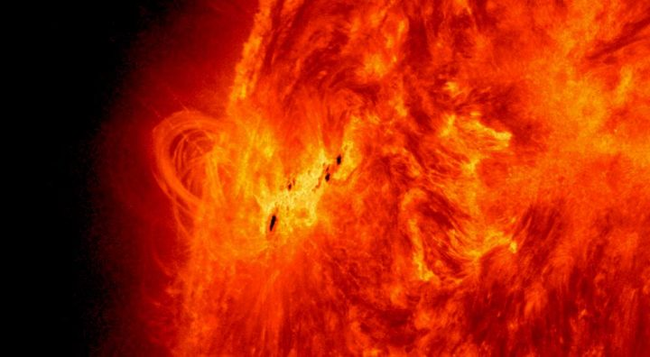 Sunspots near the region of high magnetic activity showing solar prominence.